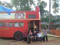Team members sit on the bus step